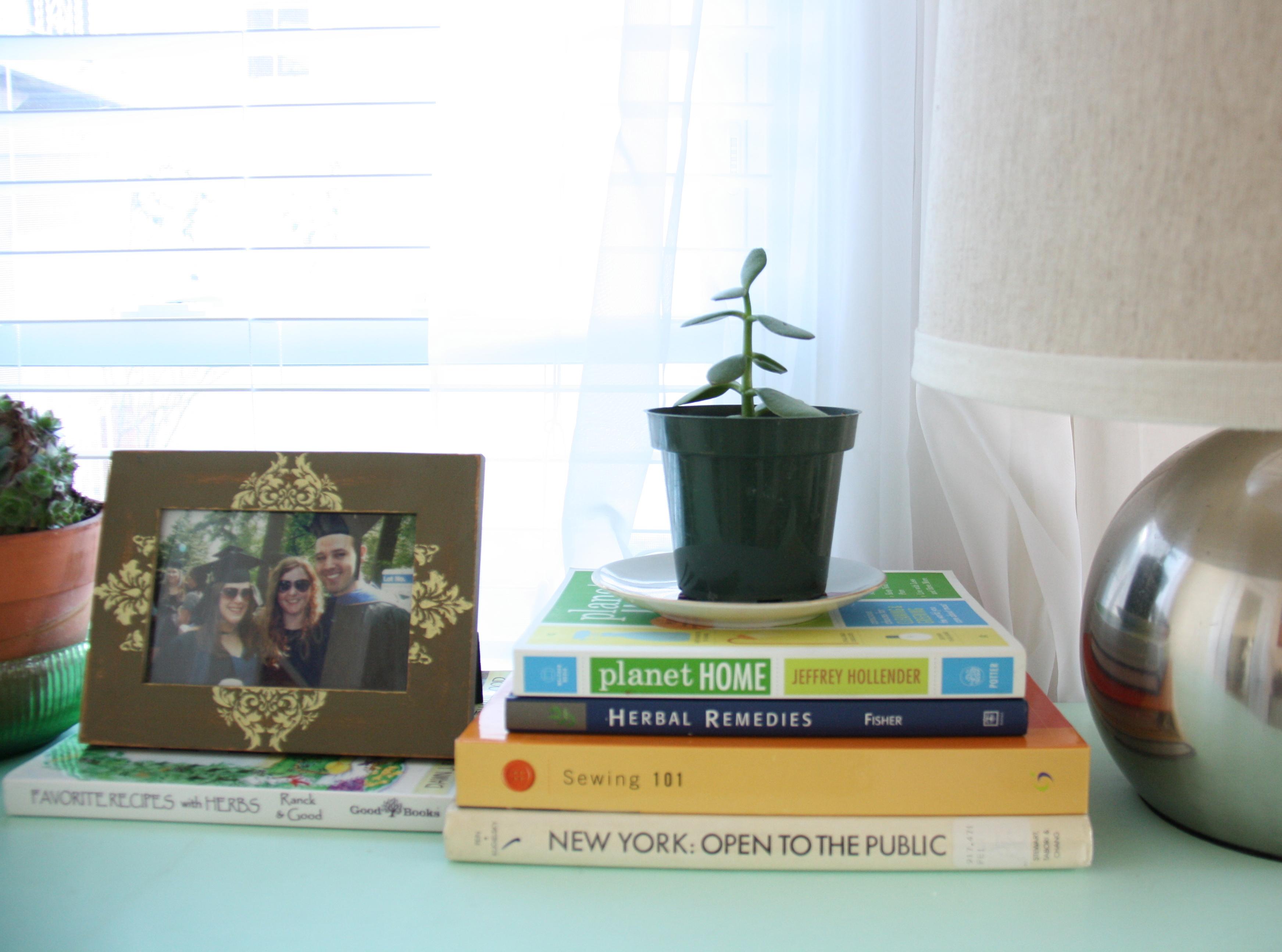Books on a blue dresser.