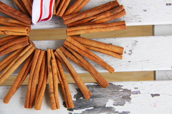 Homemade Christmas ornaments using cinnamon sticks.