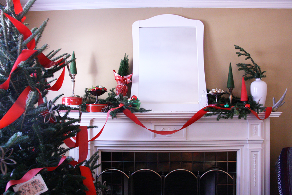 Fireplace mantle decorated for Christmas.