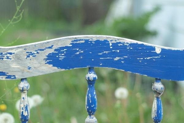 Blue shabby vintage bed headboard.