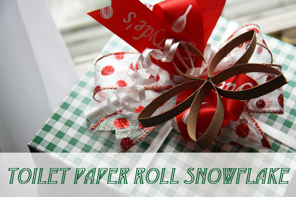 Present decorated with a toilet paper roll snowflake.