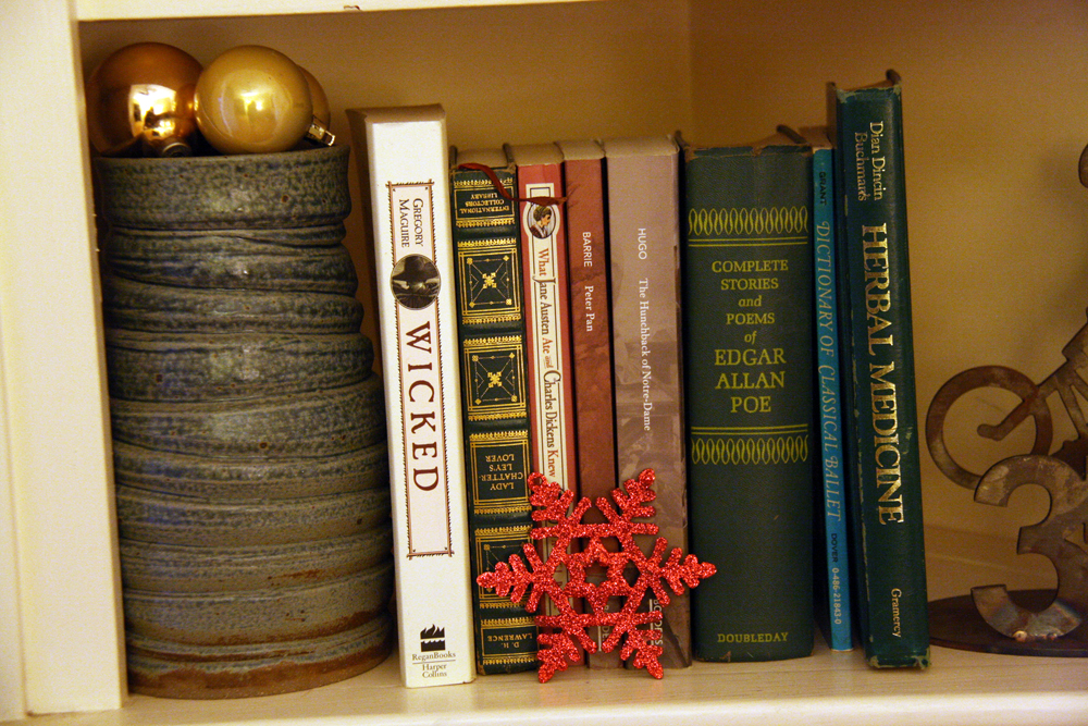 Bookcase decorated for Christmas.