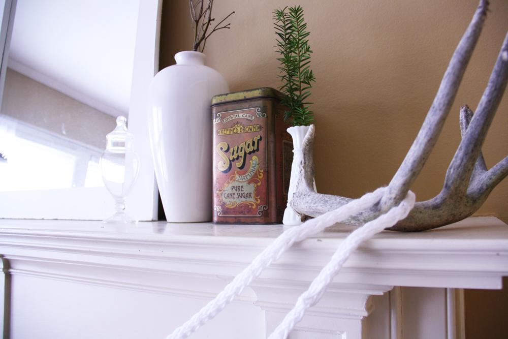 Finger knit garland displayed on a mantle.