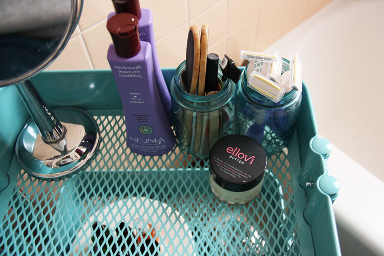 Blue cart holding bathroom supplies | redleafstyle.com