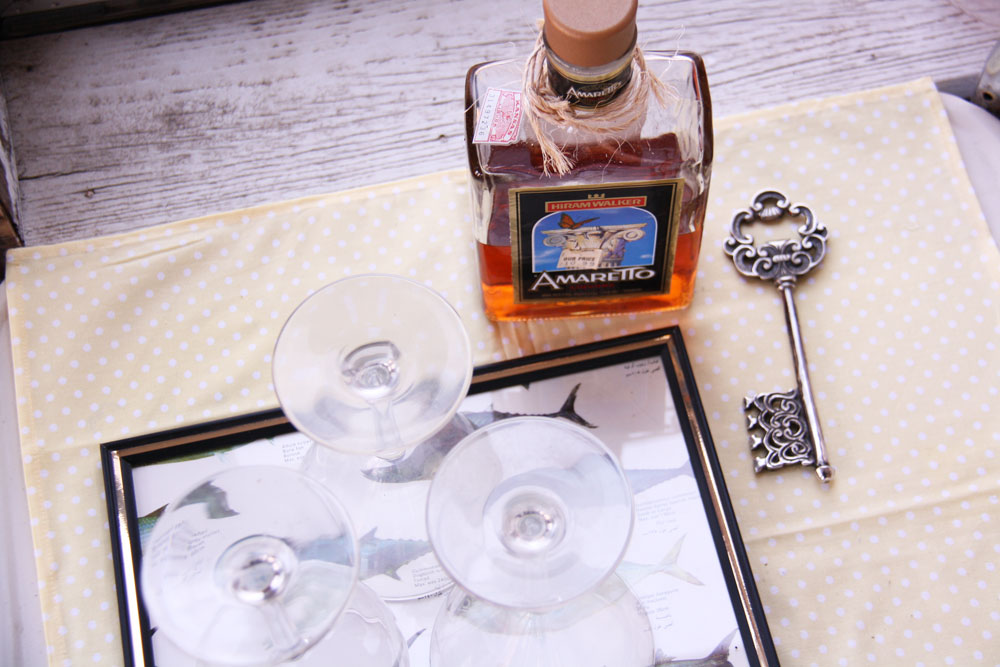Picture frame tray holding glasses on a vintage bar cart | redleafstyle.com