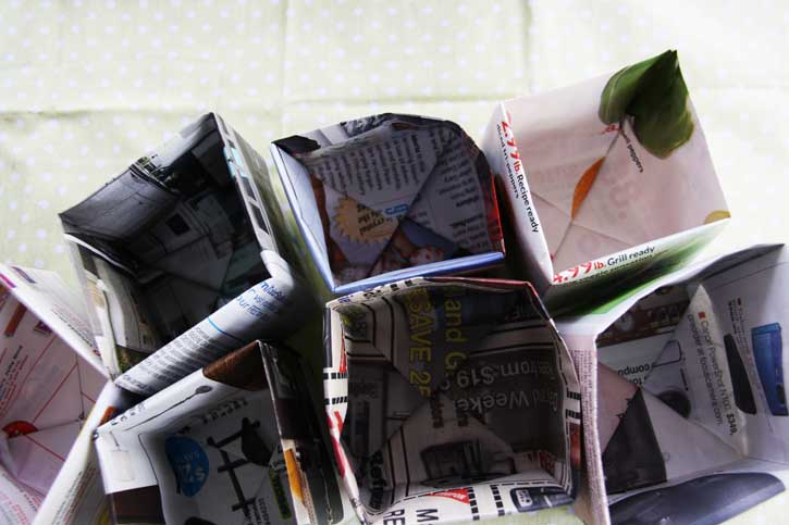Start seeds in newspaper pots | redleafstyle.com